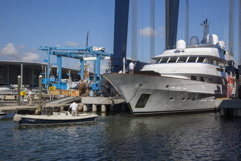 M/Y Cracker Bay on travel lift at Derecktor Shipyard in Dania Beach, FL.